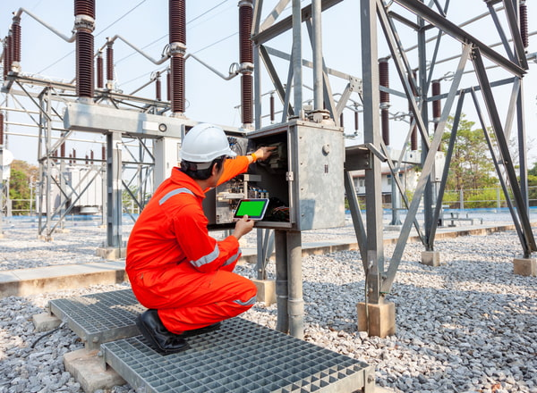 Electrical engineers inspect the electrical systems