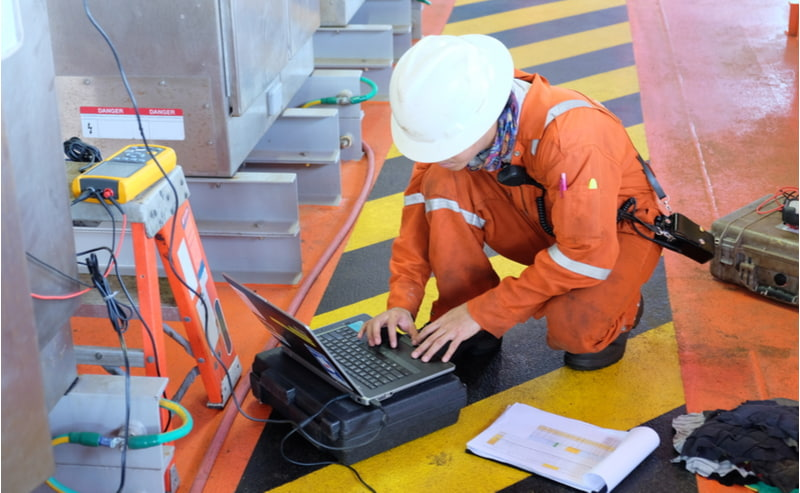 Electrical engineers monitor the operation of the control cabinet