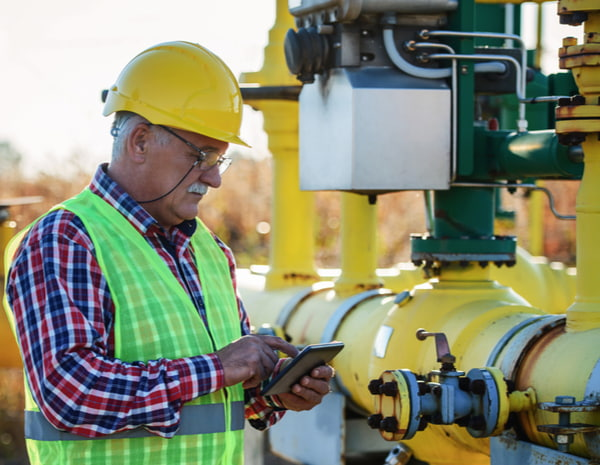 Engineer checking fuel supply systems