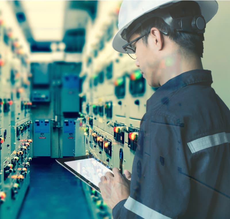 Engineer working with tablet in electrical room