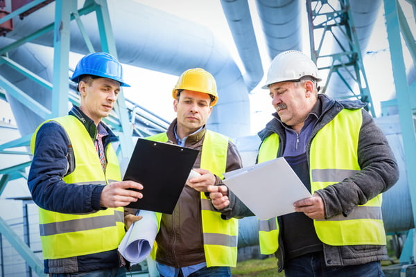 Engineers discussing maintenance of a petrochemical plant.
