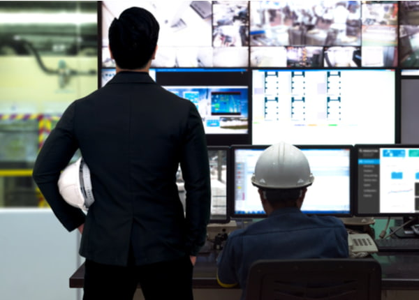 Engineer and director manager monitoring real time work