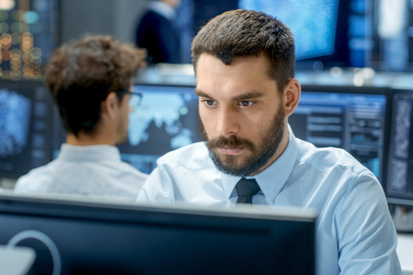 Engineer programming at his workstation