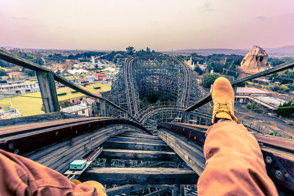 Man sitting in the front of rollercoaster